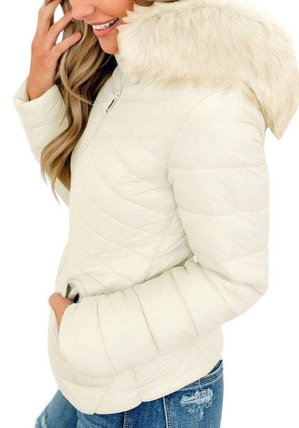 Side view of model wearing white faux-fur hood zip-up quilted jacket