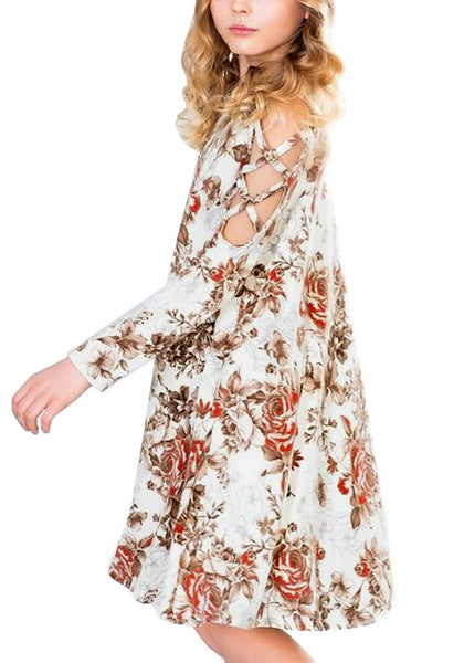 Side view of model wearing white floral crisscross cold-shoulder short flowy girl dress