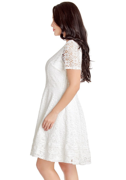 Side view of model wearing white floral hollow lace short sleeves skater dress