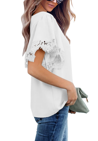 Side view of model wearing white flutter sleeves lace trim loose blouse
