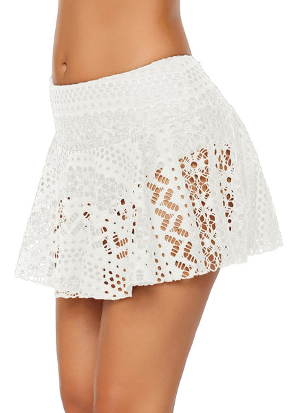 Side view of model wearing white lace crochet swim skirt