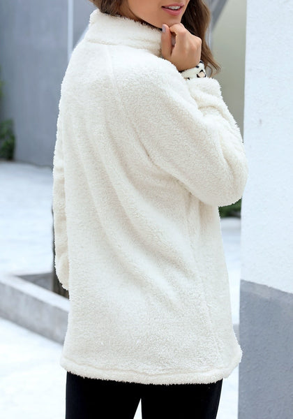 Side view of model wearing white oblique stand collar leopard fleece pullover