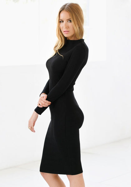 Side view of model with black mock neck midi dress