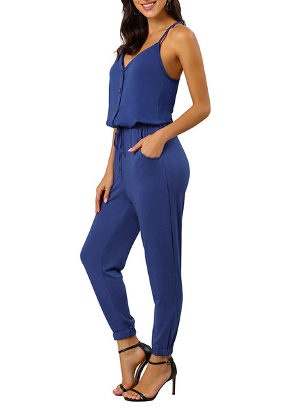 Side view of sexy model wearing blue spaghetti straps belted button-up jumpsuit