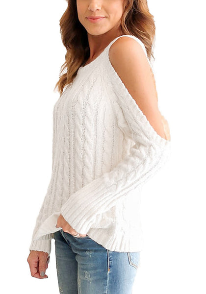 Side view of woman in white cold-shoulder cable knit sweater