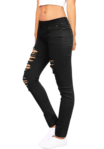 Side view of woman wearing black distressed skinny jeans