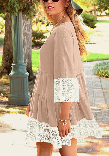 Side view of woman wearing khaki lace-trim pleated loose-fit dress