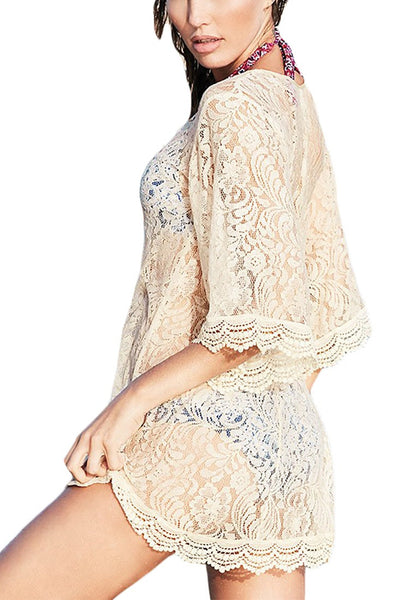 Side view of woman wearing white flare sleeves lace beach dress
