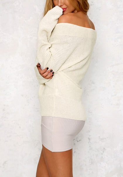 Side view pf model in white wrap off-shoulder sweater