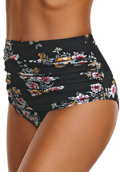 Side view of model wearing black floral-print high waist ruched swim bottom
