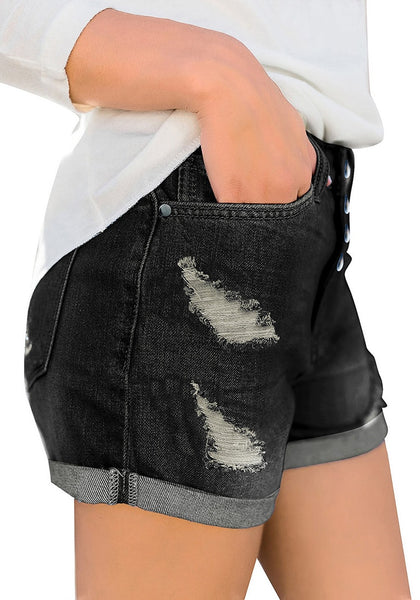 Side view of model wearing black roll-over hem button-up ripped denim shorts
