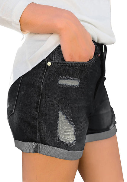 Side view of model wearing black roll-over hem ripped denim shorts