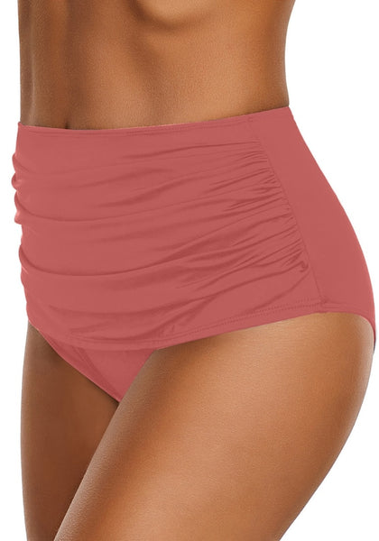 Side view of model wearing coral pink high waist ruched swim bottom