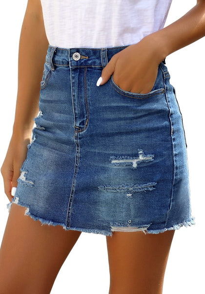 Angled shot of model wearing dark blue distressed frayed hem denim mini skirt