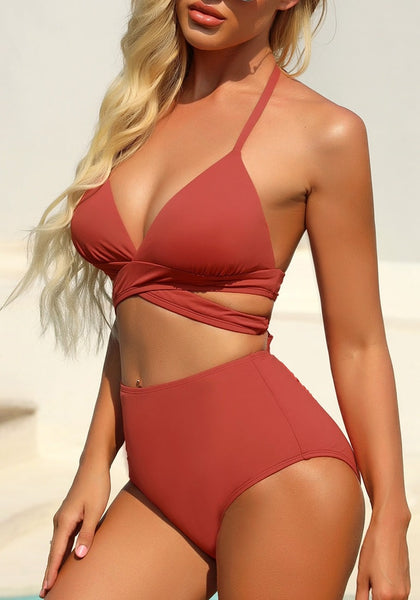 Side view of model wearing dark coral halter crisscross self-tie bikini set
