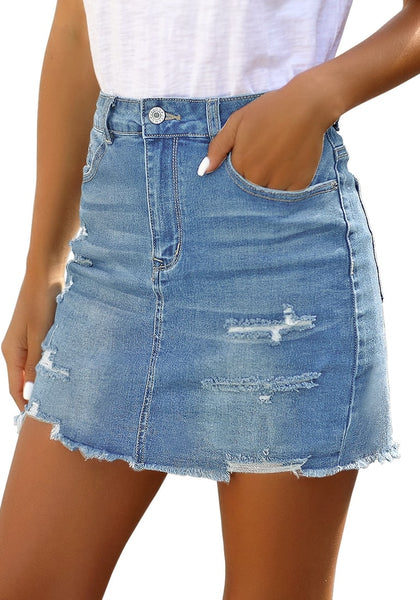 Side view of model wearing light blue distressed frayed hem denim mini skirt