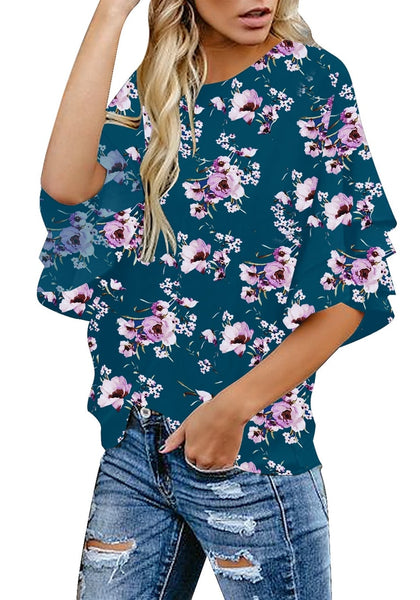 Side view of model wearing navy trumpet sleeves keyhole-back floral blouse
