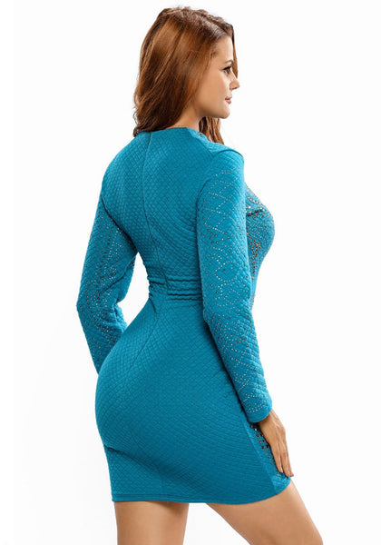 Slight back angled shot of model wearing teal jeweled quilted dress