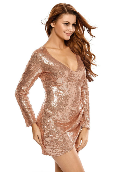 Slight left angle view of model in champagne plunge-neck sequin dress