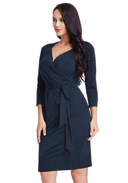 Slight left angled shot of model in plus size navy sweetheart wrap midi dress