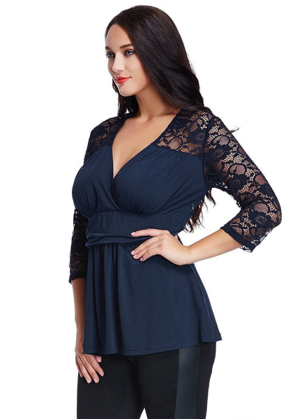 Slight left angled shot of woman in plus size navy lace navy wrap top