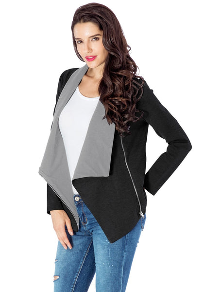 Slight left angled view of model in black oblique zipper draped cardigan
