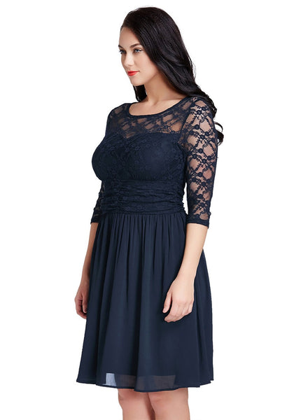 Slight left angled view of model in plus size navy lace crop-sleeves skater dress