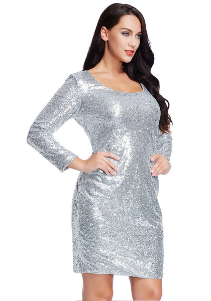 Slight right angled shot of model wearing plus size silver sequined party dress