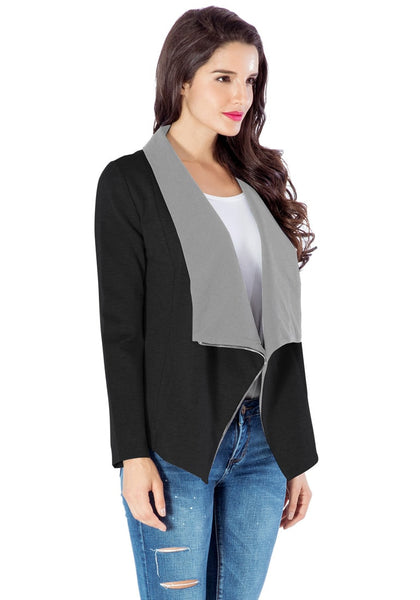 Slight right angled view of model in black oblique zipper draped cardigan