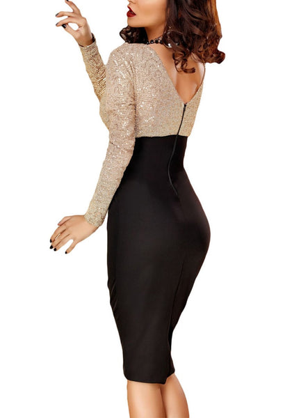Slight side and back view of woman in sequin long sleeves wrap bottom dress