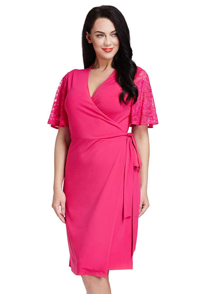 Slightl angled shot of woman in hot pink plunge wrap-style dress