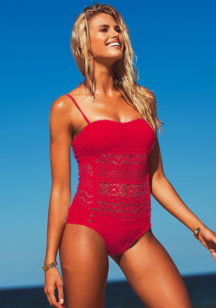 Slightly angled front view of blonde model wearing a red lace halter swimsuit