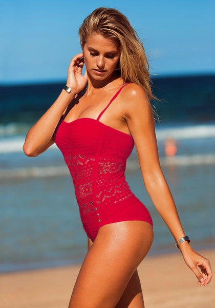 Slightly angled left side shot of blonde girl posing in a red lace halter swimsuit