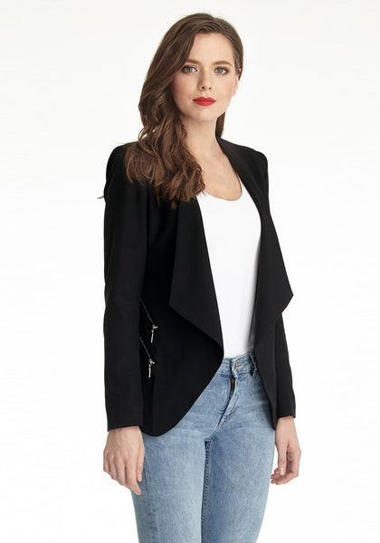 Slightly angled left side view of model wearing a black draped blazer