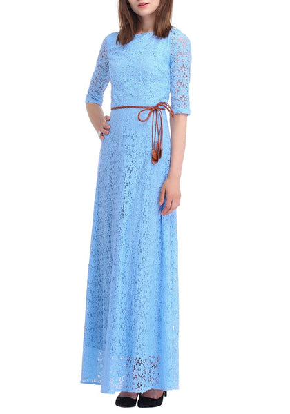 Slightly angled left side view of woman wearing a powder blue maxi dress