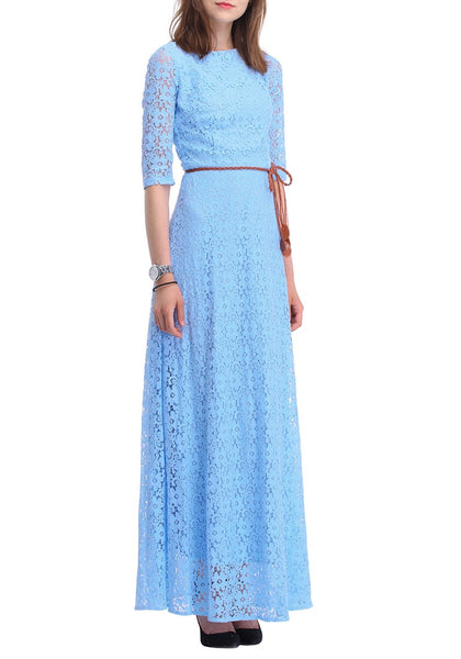 Slightly angled right side view of woman in a powder blue maxi dress