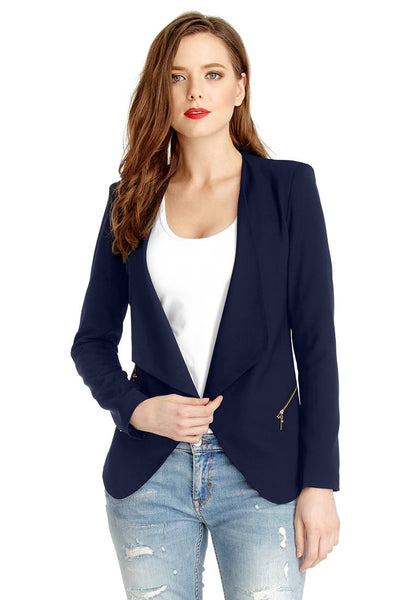 Slightly angled right side view of woman in navy blue draped blazer