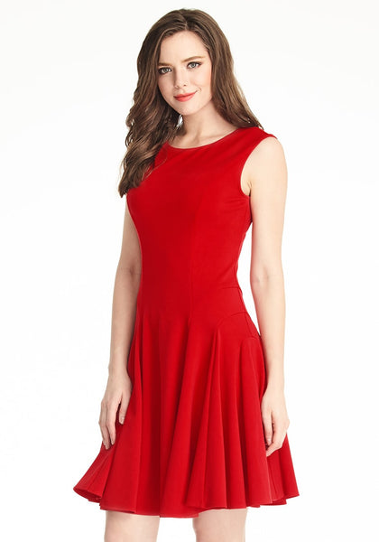 Slightly angled shot of lady in red sleeveless skater dress