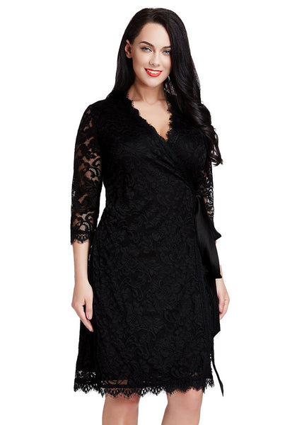 Slightly angled shot of woman in black lace crop sleeves wrap dress