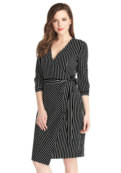 Slightly angled shot of woman in striped plunge asymmetrical belted wrap-style dress