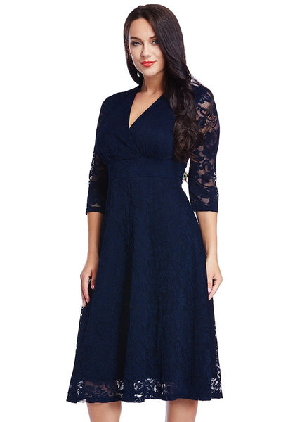 Slightly angled shot on of model in plus size navy lace surplice midi dress