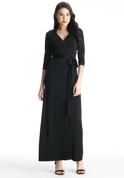 Slightly angled view of model in black plunge wrap belted maxi dress