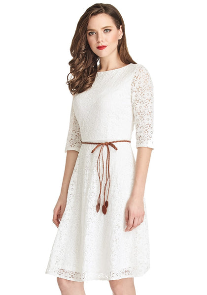 Slightly left angled shot of brunette woman in white lace crop sleeves A-line dress
