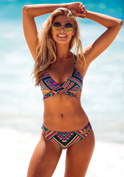 Smiling model in Aztec-print crossover bikini set
