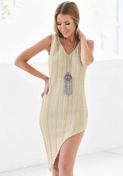 Smiling model wearing braided cable knit asymmetrical dress