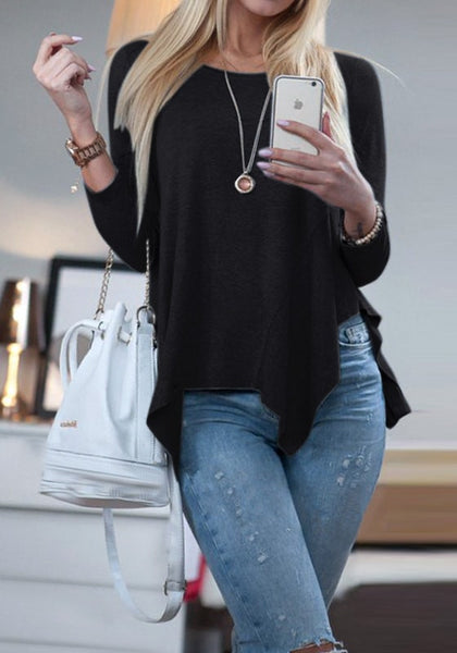 Stylish model in black asymmetrical blouse