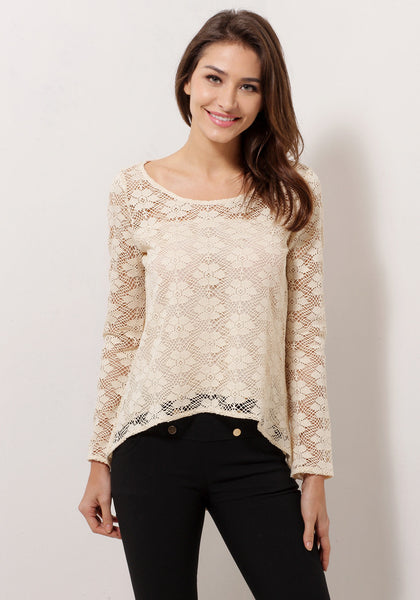 Front view of model in apricot sheer lace top