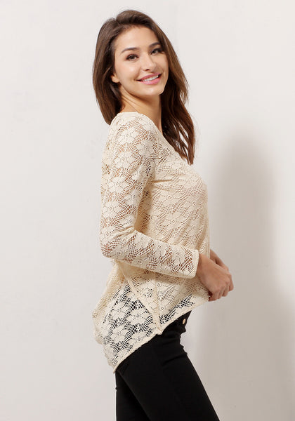 Right side view of model in apricot sheer lace top