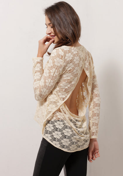 Angled back view of model in apricot sheer lace top