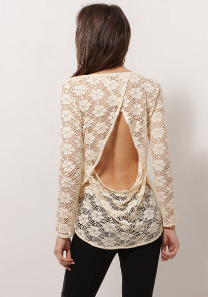 Back view of model in apricot sheer lace top